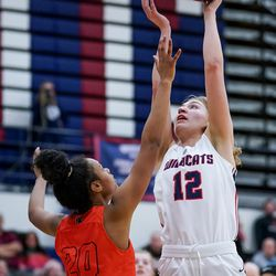 Woods Cross' Annie Michaelis goes to the hoop against Murray's Iyana Beh in a 5A girls basketball first-round game in Woods Cross on Tuesday, Feb. 18, 2020.