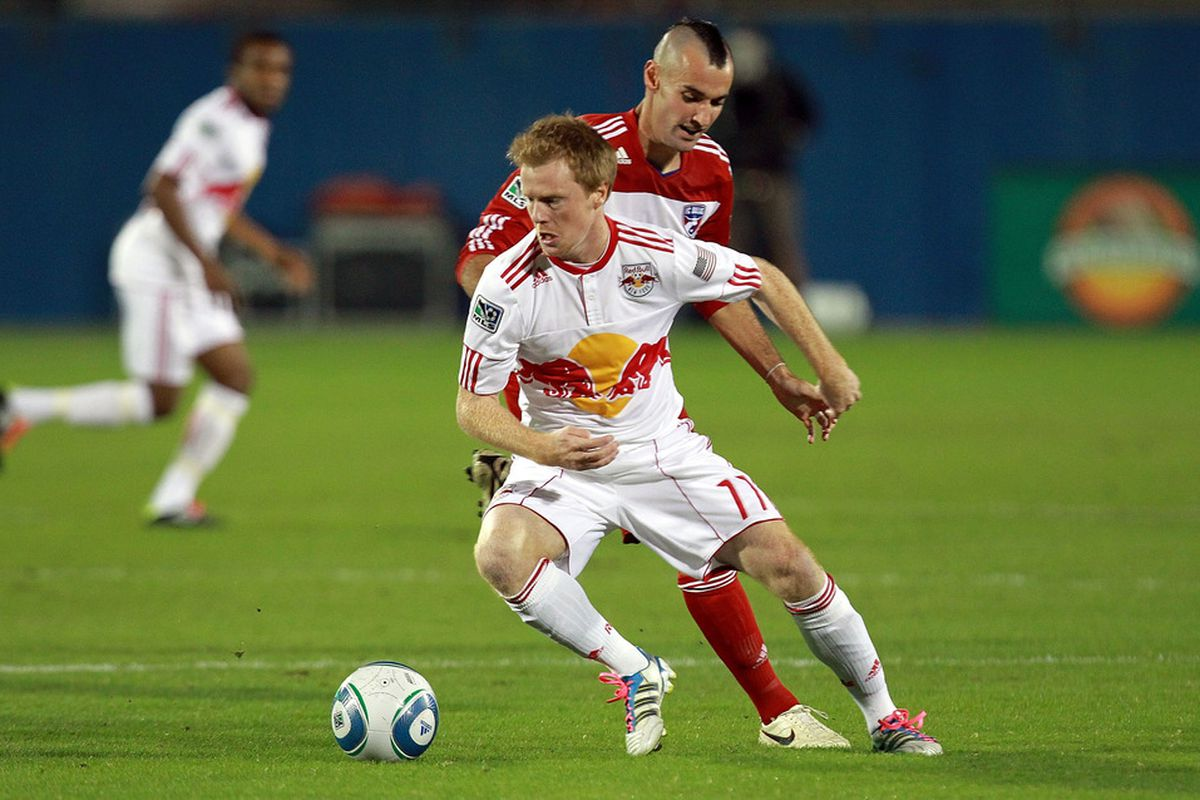 FRISCO, TX - OCTOBER 26:  Dax McCarty #11 of the New York Red Bulls dribbles the ball against Andrew Jacobson #4 of the FC Dallas at Pizza Hut Park during a  on October 26, 2011 in Frisco, Texas.  (Photo by Ronald Martinez/Getty Images)
