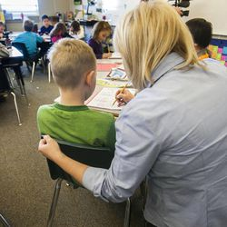 Teacher Stacey Johnsen works with her students at Daybreak Elementary School on Monday, Feb. 25, 2013. HB318, sponsored by Rep. Becky Edwards, R-North Salt Lake, would set class-size caps at 20 students for kindergarten, 22 for first and second grades, and 24 for the third grade.