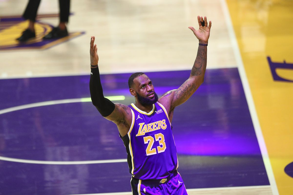 LeBron James #23 of the Los Angeles Lakers celebrates his basket at the end of the third quarter against the Memphis Grizzlies at Staples Center on February 12, 2021 in Los Angeles, California.