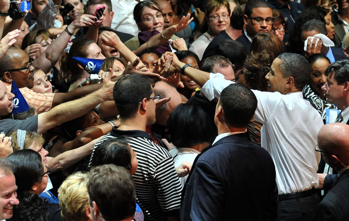 President Barack Obama shakes hands with supporters during a birthday fundraiser on August 3, 2011 at the Aragon Ballroom.