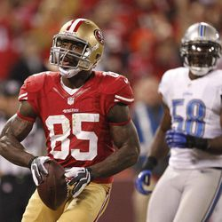 FILE - This Sept. 16, 2012 file photo shows San Francisco 49ers tight end Vernon Davis, left, reacting after scoring a touchdown during the fourth quarter of an NFL football game against the Detroit Lions in San Francisco. At right is Detroit Lions linebacker Ashlee Palmer. Davis might get fewer style points these days for his touchdown celebrations _ and he's perfectly fine with that.