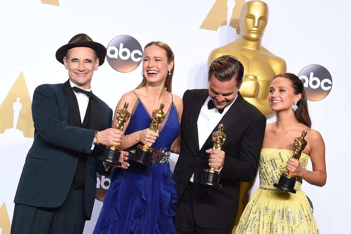 Acting winners Mark Rylance (left), Brie Larson, Leonardo DiCaprio, and Alicia Vikander celebrate backstage.