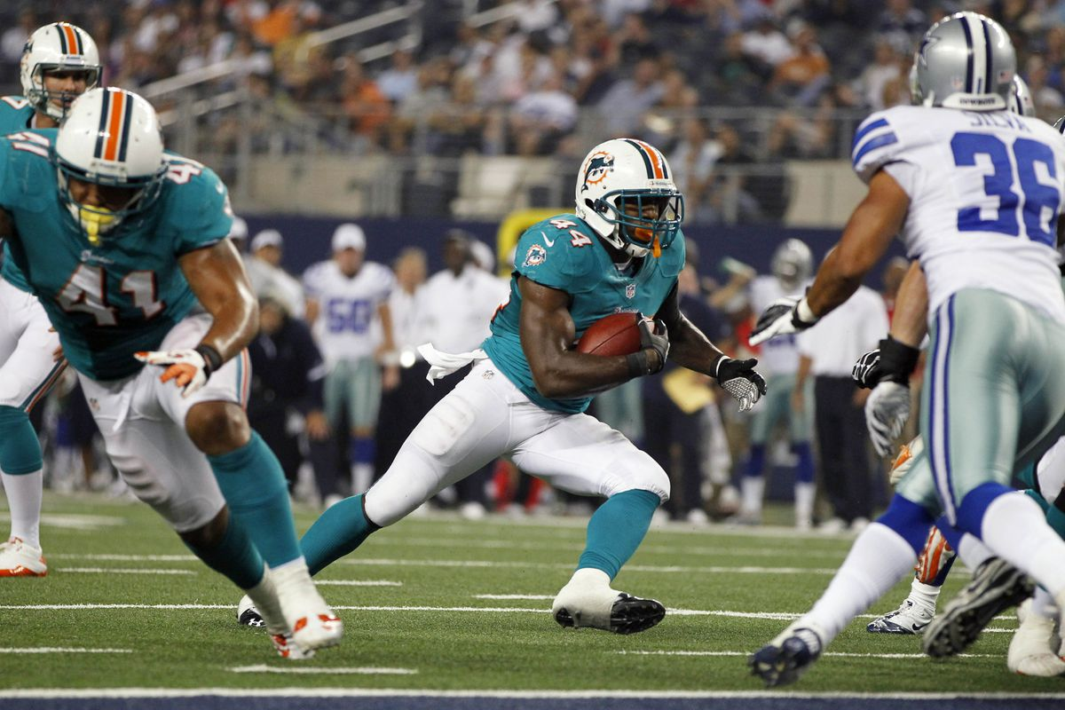 Aug 29, 2012; Arlington, TX, USA; Miami Dolphins running back Lamar Miller (44) scores a touchdown in the third quarter against the Dallas Cowboys at Cowboys Stadium. The Cowboys beat the Dolphins 30-13. Mandatory Credit: Tim Heitman-US PRESSWIRE