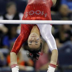 Arkansas' Stephani Canizaro competes on the uneven bars during the semifinals of the NCAA college women's gymnastics championships, Friday, April 20, 2012, in Duluth, Ga.