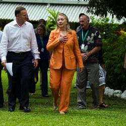 U.S. Secretary of State Hillary Rodham Clinton, center, gestures as she talks with New Zealand Prime Minister John Key, second from left, at the New Zealand high commissioner's house in Rarotonga, Cook Islands, Friday, Aug. 31, 2012.