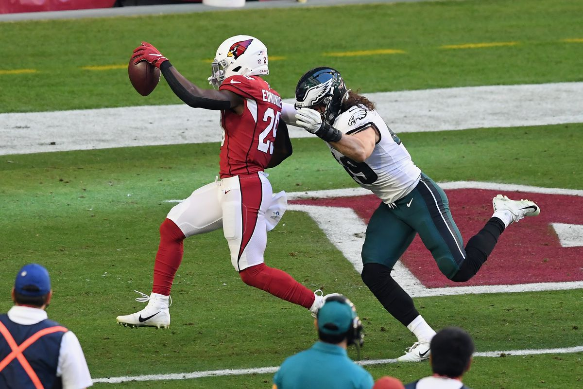 Chase Edmonds #29 of the Arizona Cardinals scores a first quarter touchdown against the Philadelphia Eagles at State Farm Stadium on December 20, 2020 in Glendale, Arizona.