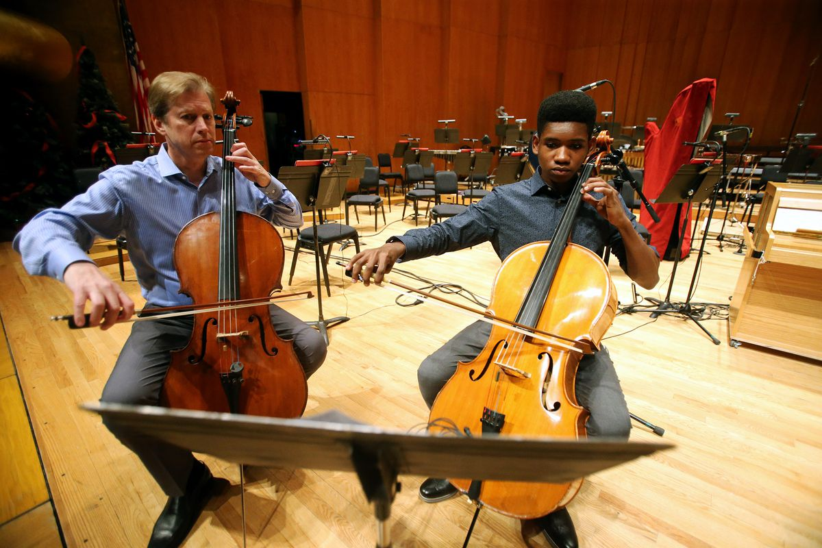 Getro Joseph, a young cellist from Haiti, plays with John Eckstein, left, of the Utah Symphony as the two have a short practice session at Abravanel Hall in Salt Lake City on Saturday, Dec. 7, 2019. Getro also met with Congressman Ben McAdams, who assisted Getro with the visa process for his trip to Utah.