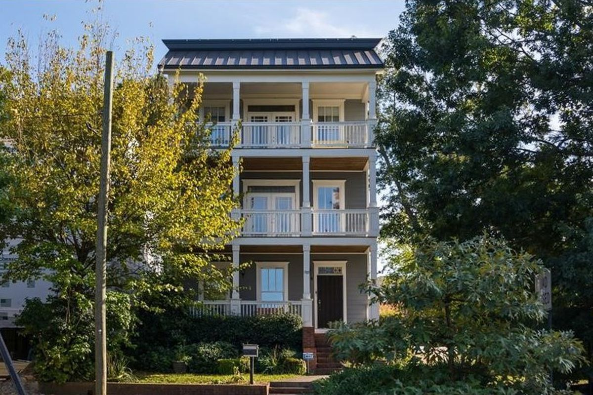 A house for sale in Atlanta's Old Fourth Ward with a rooftop deck.
