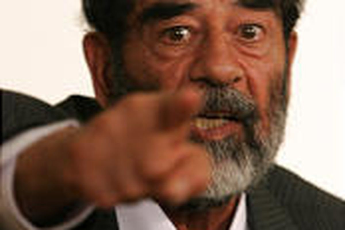 Saddam Hussein appears in a courtroom at Camp Victory, a former Saddam palace on the outskirts of Baghdad, in July 2004.