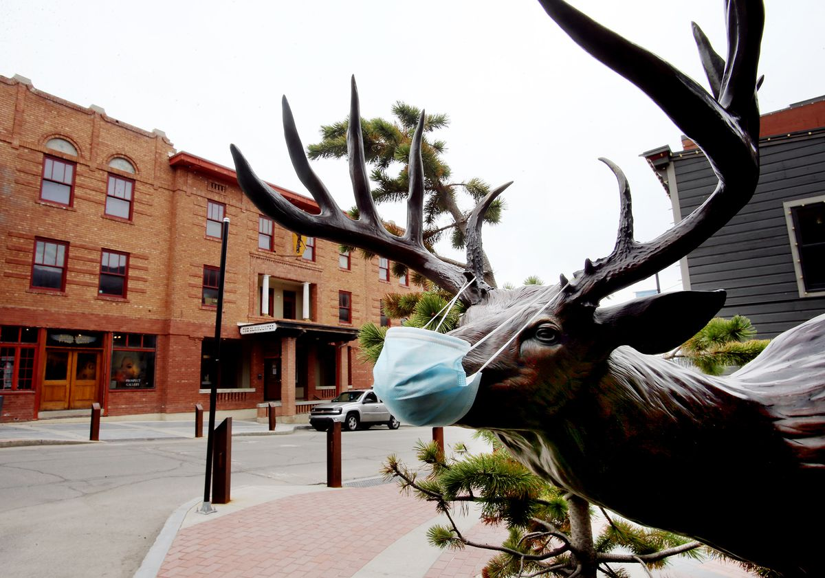 A masked deer looks out on a very slow Mair Street in Park City on Monday, April 27, 2020.