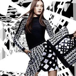 Rash Guard in Black/White Print, $29.99; Skirt in Black/White Print, $34.99.