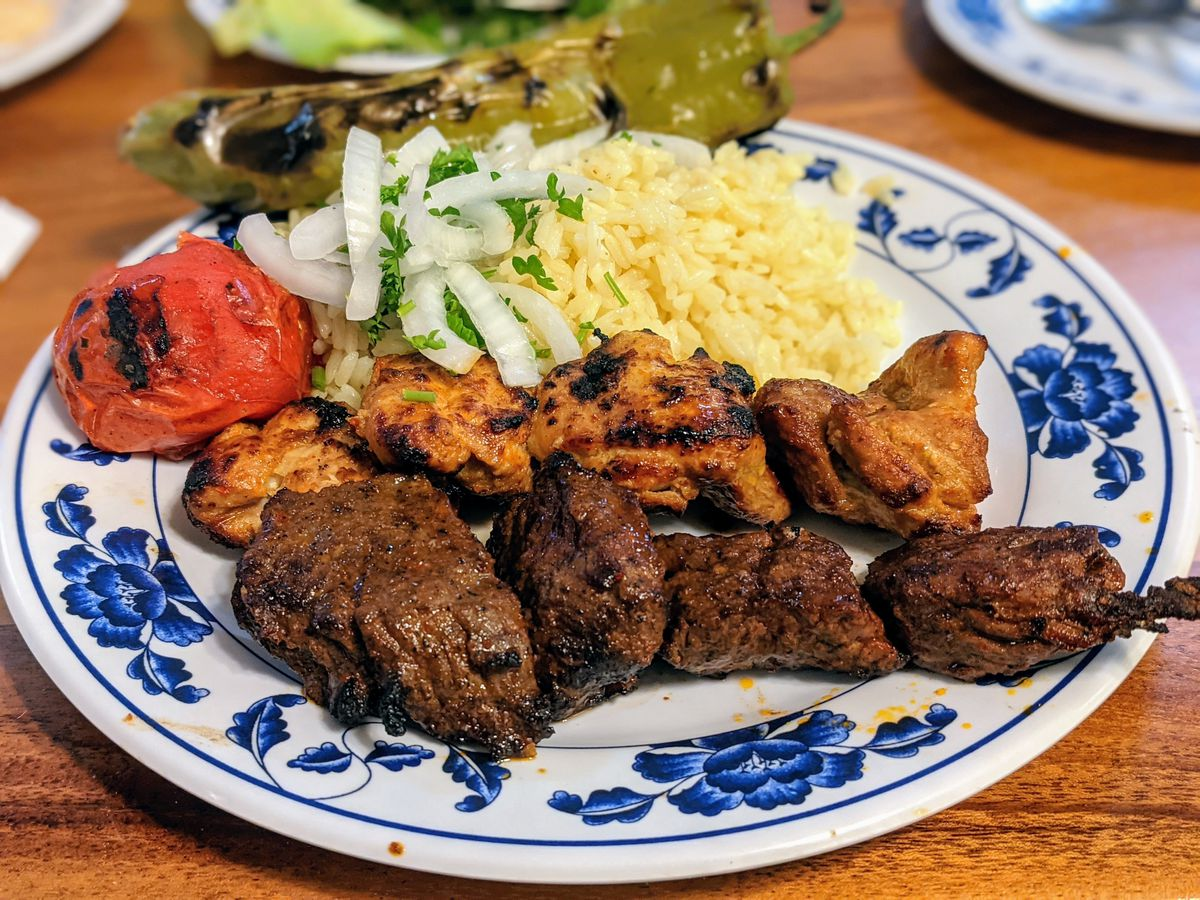 Kebabs from Elena's Greek Armenian in Glendale on a colorful blue plate.