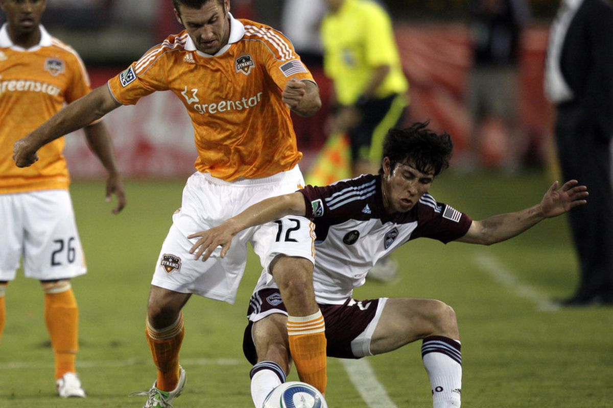 HOUSTON - MAY 04:  Forward Will Bruin #12 of the Houston Dynamo and defender Kosuke Kimura #27 of the Colorado Rapids fight for possession of the ball at Robertson Stadium on May 4, 2011 in Houston, Texas.  (Photo by Bob Levey/Getty Images)