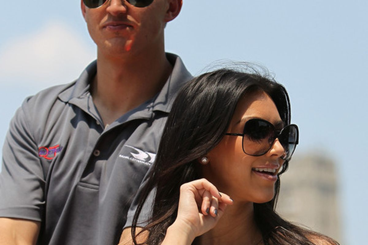 IZOD IndyCar Series driver Graham Rahal, seen here keeping up with a Kardashian. (Photo by Nick Laham/Getty Images)