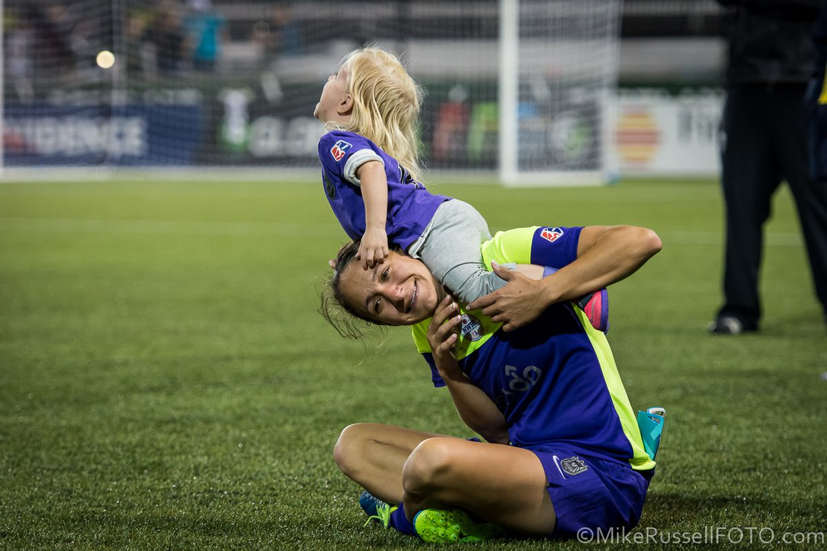 Stephanie Cox plays with her daughter after the 2015 NWSL Final