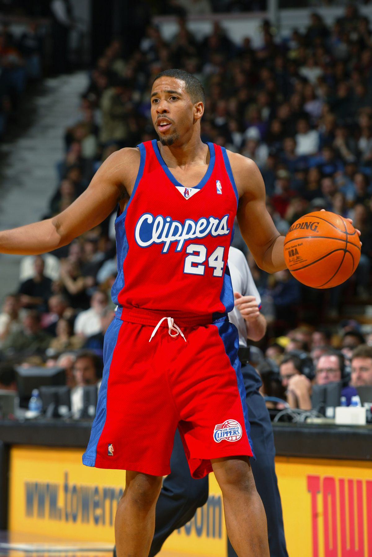 Andre Miller moves the ball
