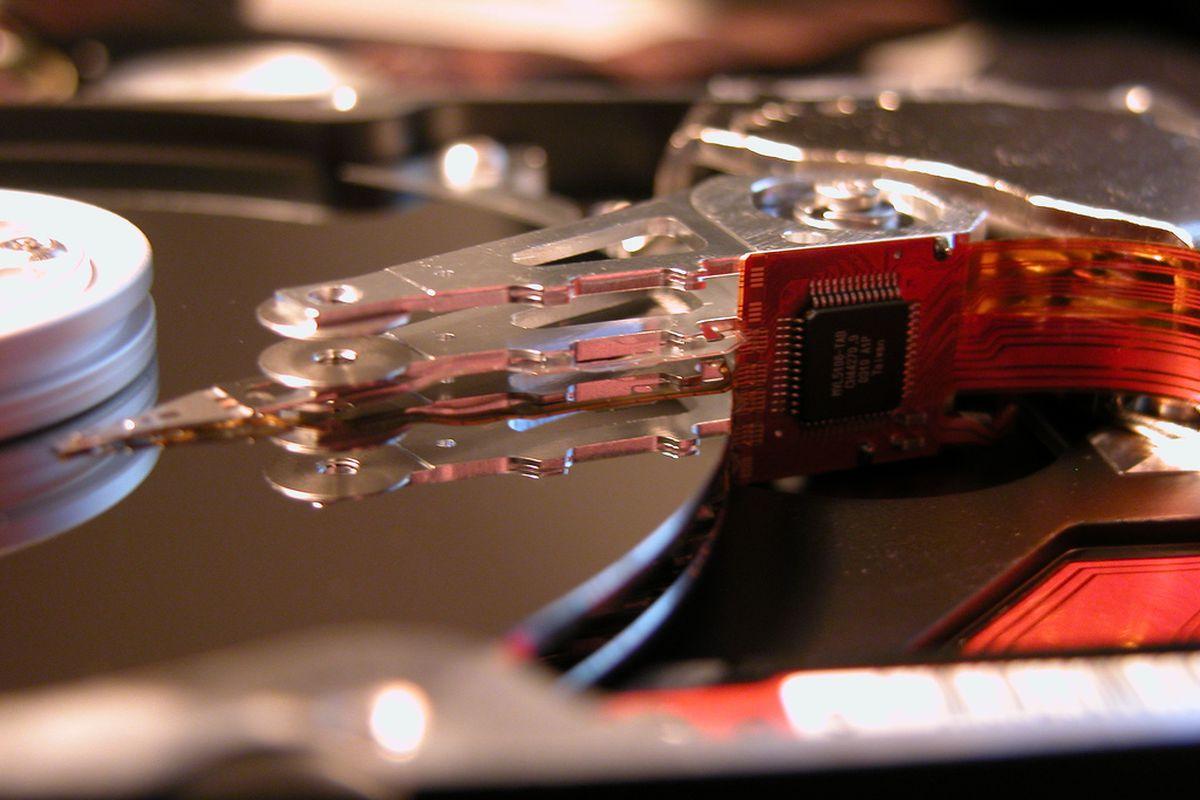 hard drive platter actuator arm (flickr lyrandian)