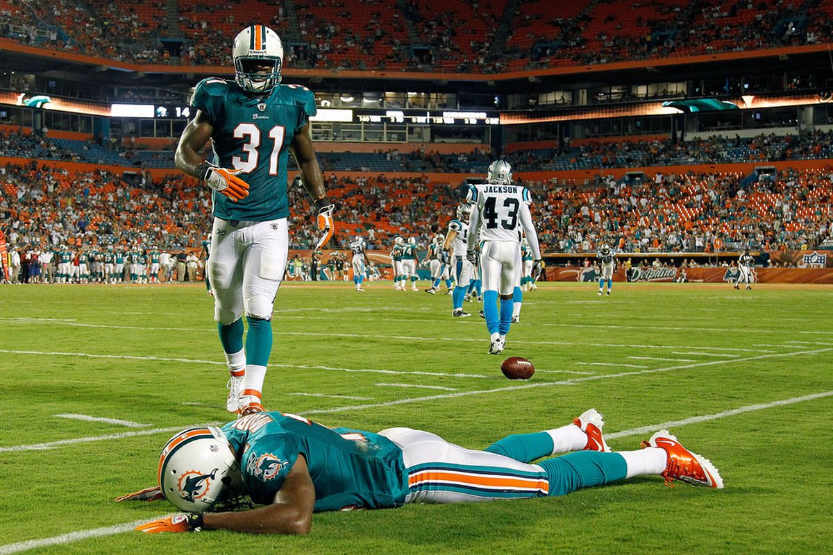 Miami Dolphins wide receiver Marlon Moore may not want to repeat this moment from last year's preseason game with the Carolina Panthers.