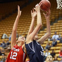 Utah's Emily Potter and BYU's Jennifer Hamson reach for the rebound during a women's basketball game at the Marriott Center in Provo on Saturday, Dec. 14, 2013. Utah won in double overtime 82-74.