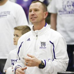 Weber State Wildcats head coach Randy Rahe smiles as his team is selected for the NCAA Tournament in Ogden Sunday, March 16, 2014.