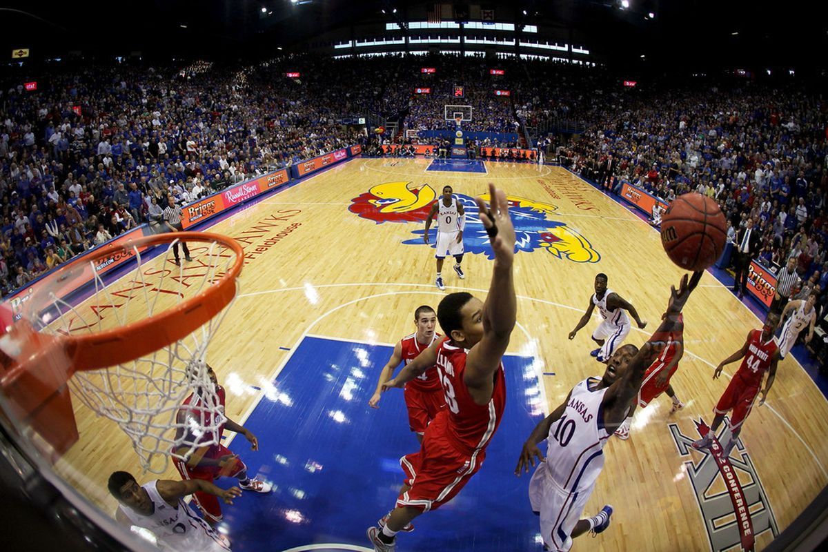 LAWRENCE, KS - DECEMBER 10: Tyshawn Taylor #10 of the Kansas Jayhawks shoots over Amir Williams #23 of the Ohio State Buckeyes during the game on December 10, 2011 at Allen Fieldhouse in Lawrence, Kansas.  (Photo by Jamie Squire/Getty Images)