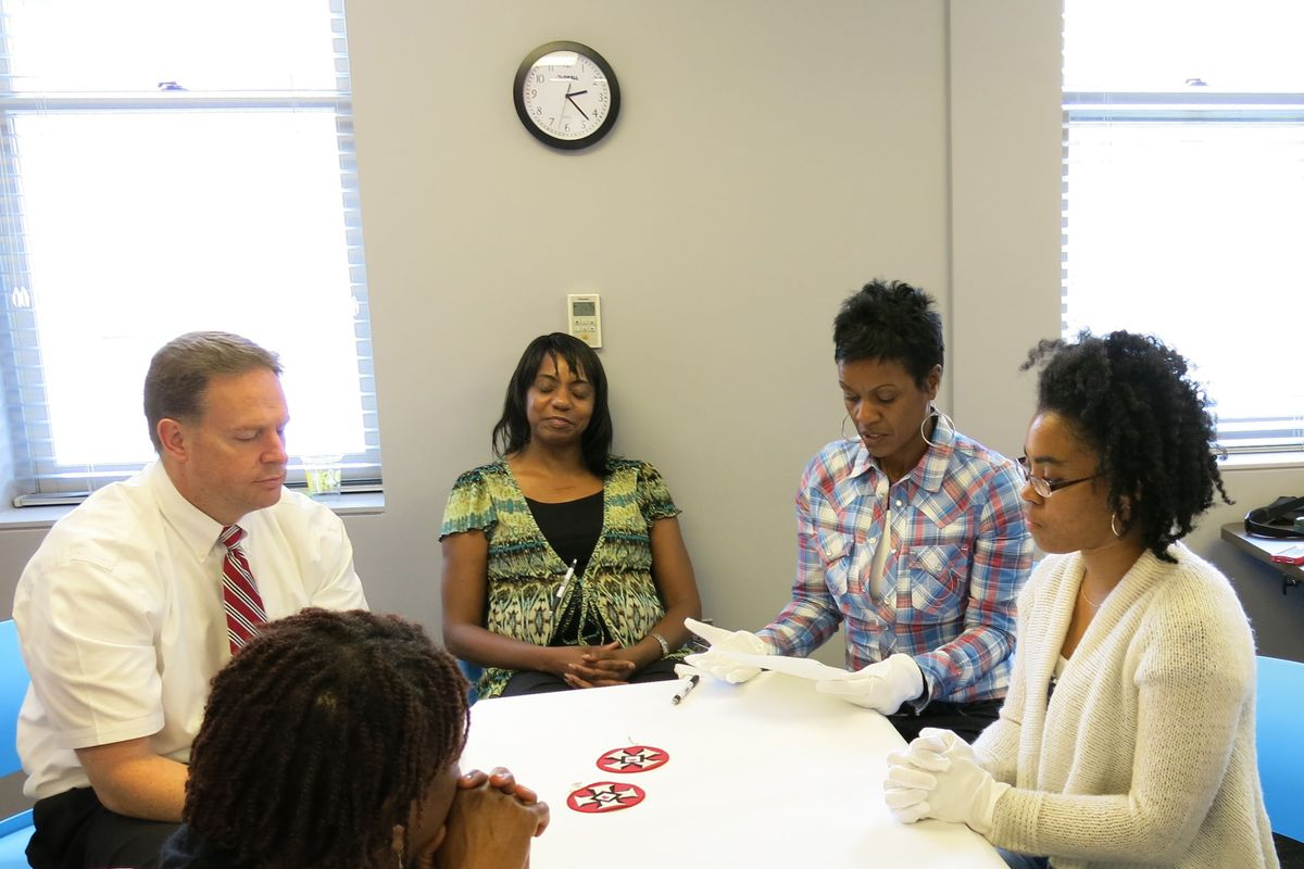 Teachers at the National Civil Rights Museum's first teacher institute discuss museum artifacts.