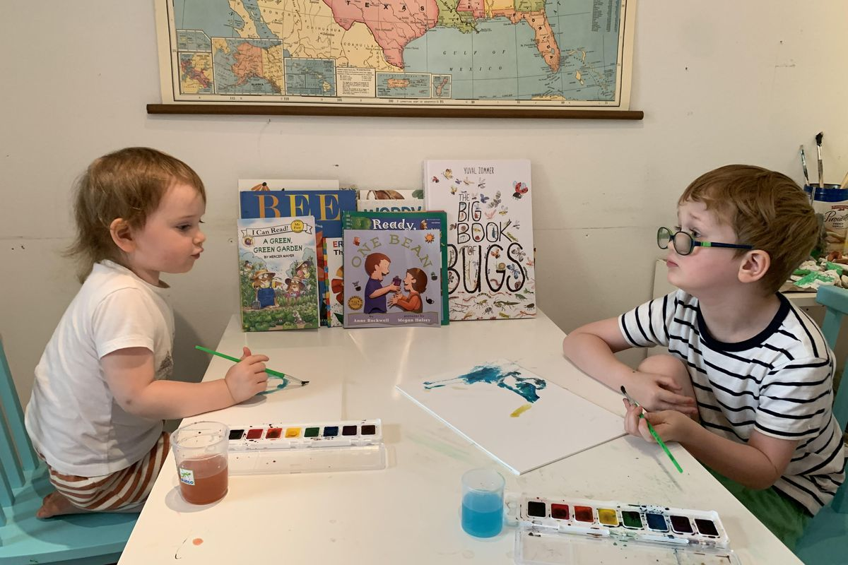 Five-year-old Logan Walker, right, and his 3-year-old sister,Sojourner,paint at a table in a makeshift classroom at their Boulder home.
