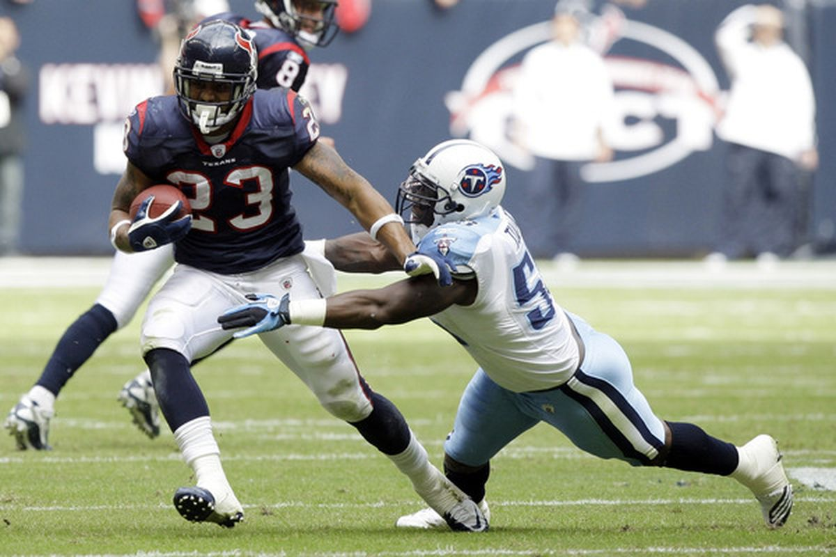 HOUSTON - NOVEMBER 28:  Running back Arian Foster #23 of the Houston Texans avoids a tackle from linebacker Stephen Tulloch #55 of the Tennessee Tians at Reliant Stadium on November 28 2010 in Houston Texas.  (Photo by Bob Levey/Getty Images)