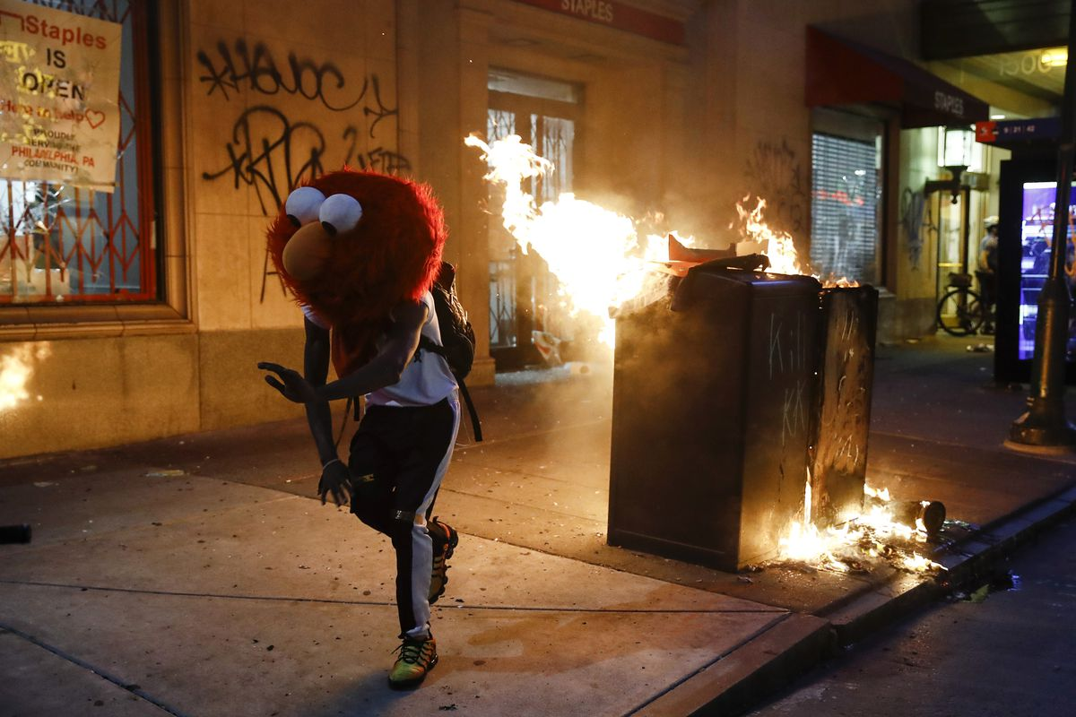 A protester in an Elmo mask dances during the Justice for George Floyd Philadelphia Protest on Saturday, May 30, 2020. Demonstrators took to the streets across the United States to protest the death of Floyd, a black man who was killed in police custody in Minneapolis on May 25. (AP Photo/Matt Rourke)