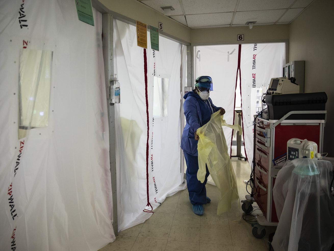 A nurse suits up with protective equipment before entering the COVID-19 unit last year at Roseland Community Hospital. ICU beds were full for all of southern Illinois Monday night.