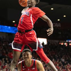 Devonaire Doutrive (1) vaults over Ira Lee (11) during the 2018 Red-Blue dunk contest in McKale Center on October 14 in Tucson, Ariz.