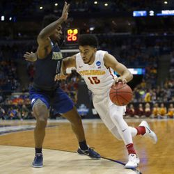 Iowa State's Nazareth Mitrou-Long (15) drives around Nevada's Marcus Marshall (1) during the first half of an NCAA college basketball tournament first-round game Thursday, March 16, 2017, in Milwaukee. (AP Photo/Kiichiro Sato)