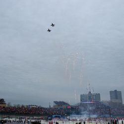 Navy jets fly over Wrigley Field after the anthem