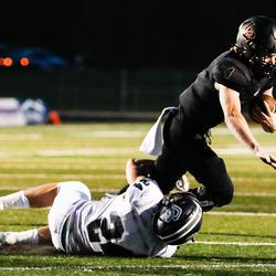 Lone Peak quarterback Luke Romney (4) carries the ball for a first down against the Corner Canyon defense during a high school football game at Lone Peak High School in Highland on Thursday, Sept. 24, 2020.
