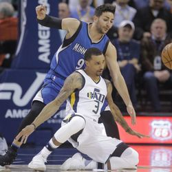 Utah Jazz guard George Hill (3) falls as Minnesota Timberwolves guard Ricky Rubio (9) defends during the first half in an NBA basketball game Wednesday, March 1, 2017, in Salt Lake City. (AP Photo/Rick Bowmer)