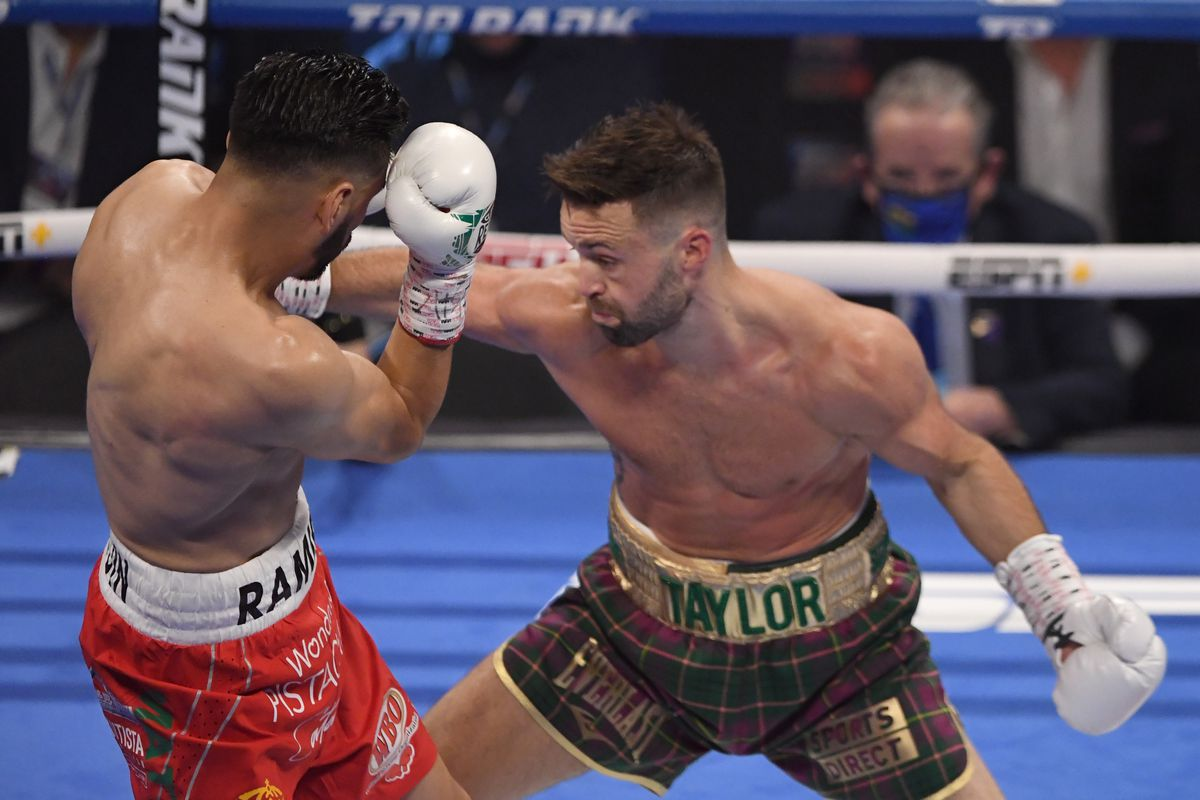 Josh Taylor lands a body shot against Jose Ramirez in their junior welterweight unification title fight