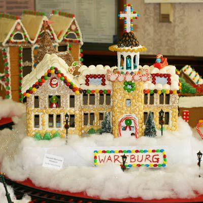 Gingerbread chapel with a sign in front of it that says Wartburg.
