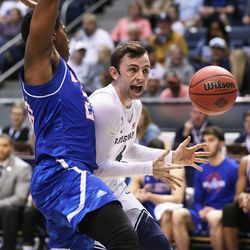 Brigham Young Cougars guard Nick Emery (4) loses the ball with Texas Arlington Mavericks forward Julian Harris (20) defending as BYU and the University of Texas at Arlington play in NIT basketball action at the Marriott Center in Provo, Utah on Wednesday, March 15, 2017.