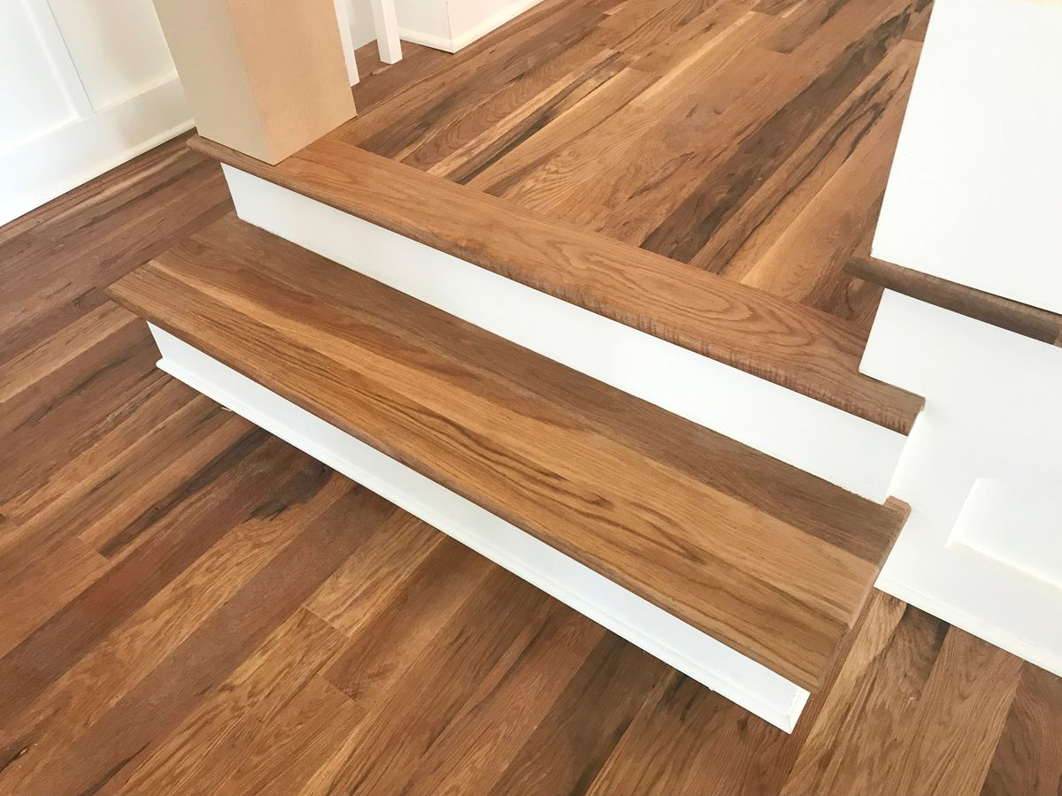 Hardwood floor and stairs.