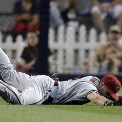 Arizona Diamonbacks center fielder Adam Eaton drops a catch off a hit by the San Diego Padres' Chris Denorfia in the first inning of a baseball game on Friday, Sept. 7, 2012, in San Diego. Denorfia singled on the play.