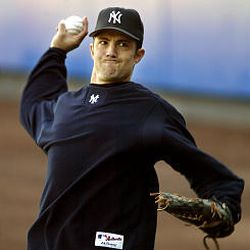 New York Yankees pitcher Mike Mussina throws on the field during a workout for the American League Championship Series on Monday at Yankee Stadium in New York. Mussina is scheduled to be the Yankees' starting pitcher for Game 1 of the series against the Boston Red Sox, which begins tonight.