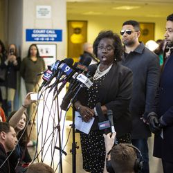 Jussie Smollett listens as his attorney, Patricia Brown Holmes, speaks to reporters.   Ashlee Rezin/Sun-Times