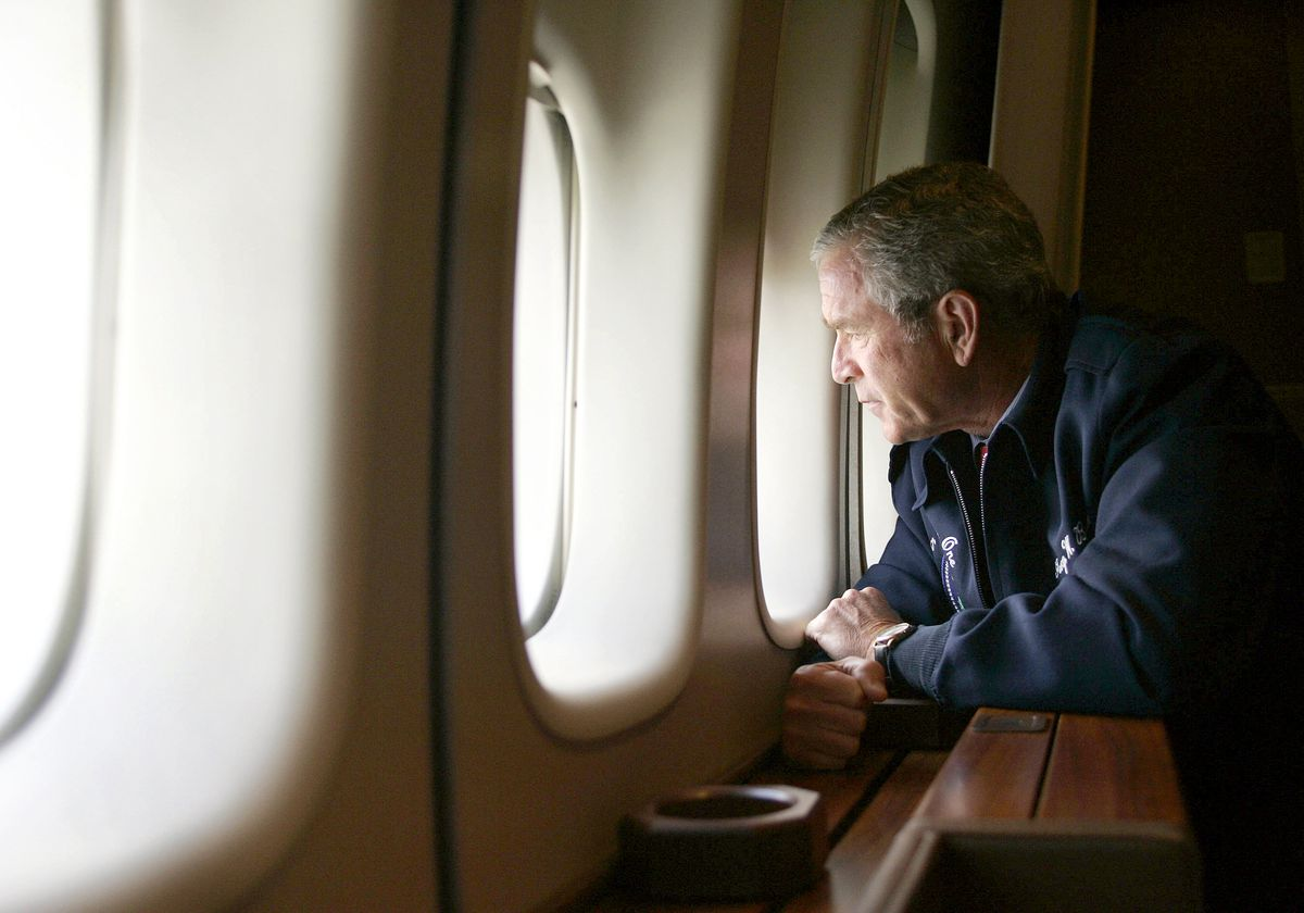 President George W. Bush looks out the window of Air Force One as he flies over New Orleans after Hurricane Katrina ravaged the region.