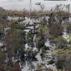 This aerial photo shows a car in floodwaters on Hwy. 23 in the aftermath of Hurricane Isaac. in Plaquemines Parish, La., Wednesday, Sept. 5, 2012. Thousands of electric customers are still without power, hundreds remained in shelters and several miles of coast line was tarred with weathered oil washing ashore, days after Isaac raked Louisiana.