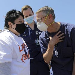 Ana Lucio, who was fighting COVID-19 on a ventilator this time last year, catches up with Lakeview Hospital progressive care unit nurse mentor Paul Griffith, who transferred Lucio into the intensive care unit and helped translate for her to let her know what was going to happen, as they gather for an Alex Boyé concert at the Bountiful hospital on Tuesday, May 4, 2021. Lucio was in the hospital for more than two months and was Lakeview's longest COVID-19 admission. She was discharged in May 2020.