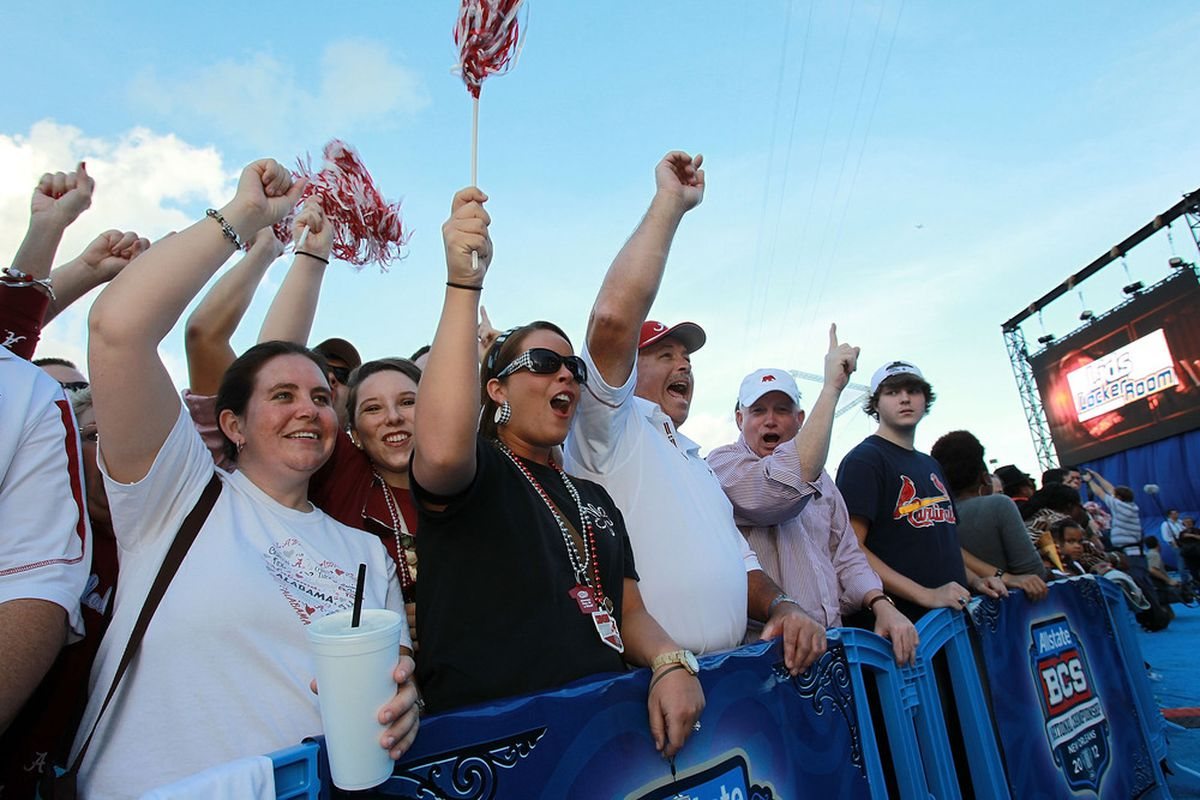 NEW ORLEANS, LA - JANUARY 08:  Alabama Crimson Tide fans cheer at the Allstate Fan Fest on January 8, 2012 in New Orleans, Louisiana.  LSU and Alabama will play in the BCS National Championship on January 9th.  (Photo by Ronald Martinez/Getty Images)