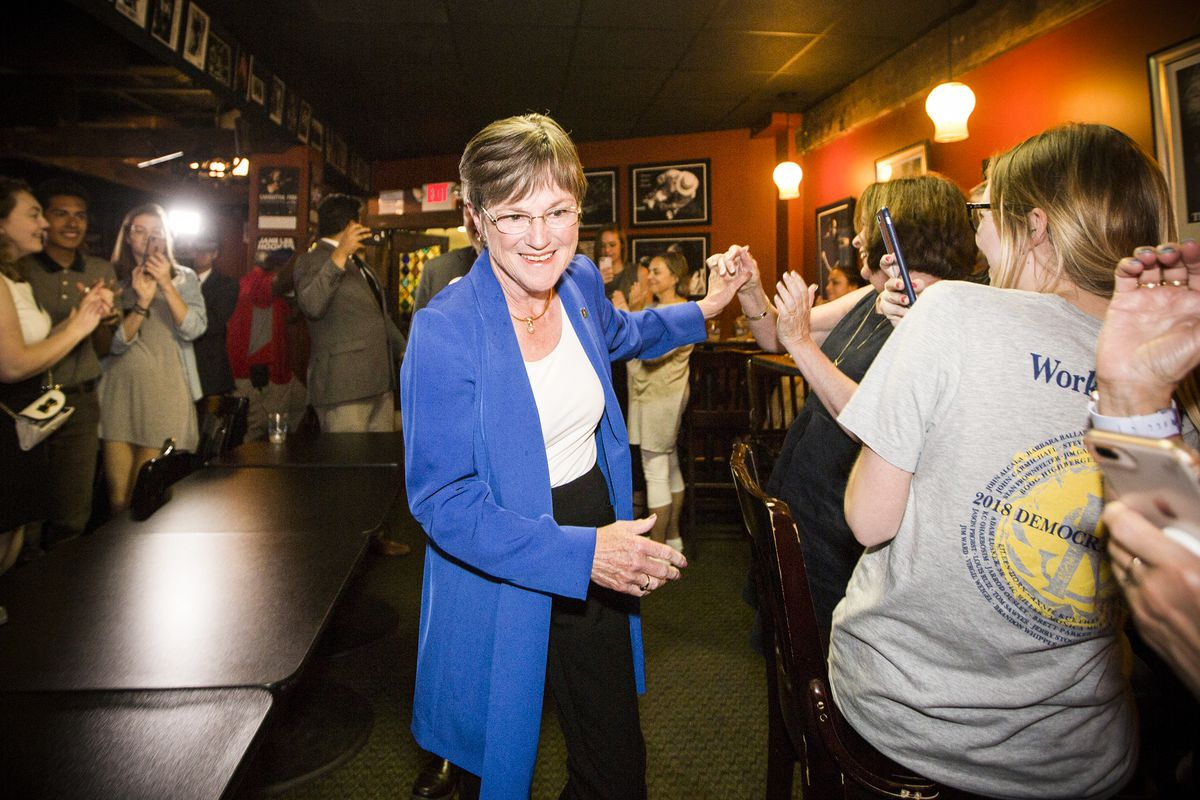 Democratic gubernatorial candidate Laura Kelly is congratulated by supporters at her campaign party in Topeka moments after she won the Democratic primary on August 07, 2018.