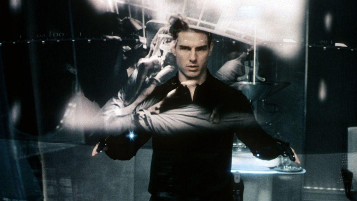 tom cruise looks at a futuristic screen