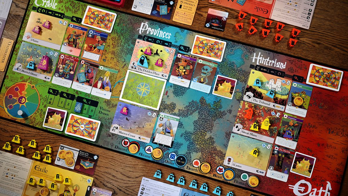 The base game of Oath laid out to play for six. The central game board is made of cloth, like a mousepad.